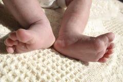 Stretching feet. Newborn baby stretching feet in sun Royalty Free Stock Image