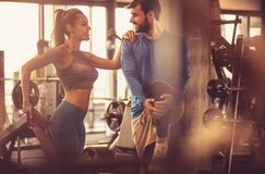 Stretching first of all. Teamwork in gym. Couple working exercise together royalty free stock photos