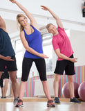 Stretching on fitness classes Stock Images