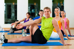 Stretching in fitness club Stock Image