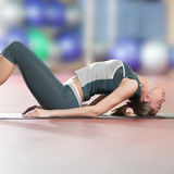 Stretching fitness exercise at sport gym. Yoga Stock Photos
