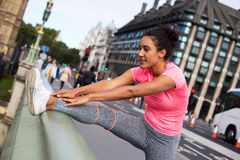 Stretching. Fitness woman stretching her leg muscles Stock Images