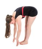 Stretching fitness woman touching the floor with her fingers Royalty Free Stock Images