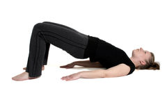 Stretching on floor. Woman in black stretching Royalty Free Stock Photos
