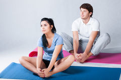 Stretching on floor exercise mat Royalty Free Stock Photography