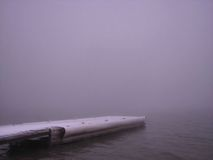 Stretching Into The Fog - Orman Dam Royalty Free Stock Photography