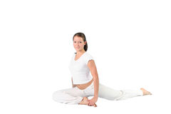 Stretching  girl. The sports girl in a pose yoga on a white  background Stock Photo