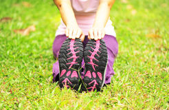Stretching on grass Royalty Free Stock Image