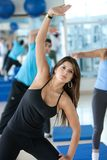 Stretching at the gym Stock Image