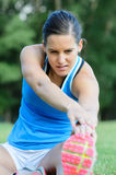 Stretching Hamstring. Athlete woman stretching legs and femoral muscles Royalty Free Stock Photos