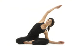 Stretching happily. A beautiful Asian woman stretching. Shot in studio Stock Photos