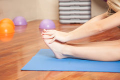Stretching her feet Stock Photography