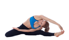 Stretching of ischio, obliques, adductors and quadriceps stock photo