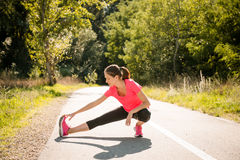 Stretching before jogging Royalty Free Stock Photos