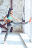 Stretching keeps her strong. Royalty Free Stock Photo