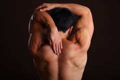 Stretching left arm backwards Stock Image