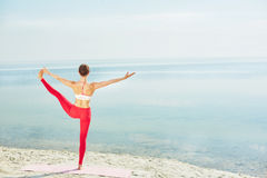Stretching leg on beach Stock Photos