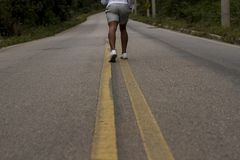 Stretching of the legs for morning jogging royalty free stock photography