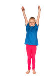 Stretching little girl Royalty Free Stock Images