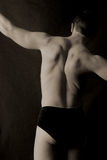 Stretching male back Royalty Free Stock Images