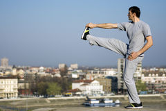 Stretching man outdoors Stock Photography