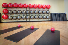 Stretching mats and exercise balls in gym Stock Images