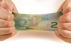 Stretching money Royalty Free Stock Photo