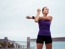 Stretching before my workout Royalty Free Stock Images