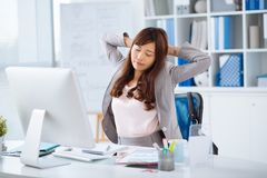 Stretching office worker Royalty Free Stock Photo