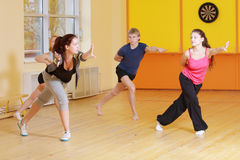 Stretching out forward in group aerobics Stock Photography