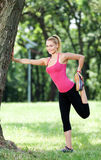 Stretching outdoors Stock Photography