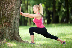Stretching outdoors Royalty Free Stock Images