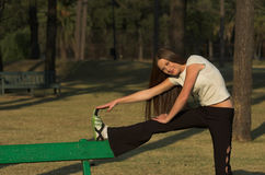 Stretching on park bench Royalty Free Stock Images
