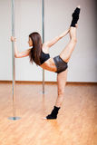 Stretching for pole dancing class Royalty Free Stock Images