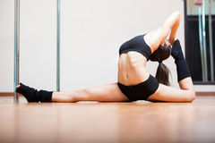 Stretching in pole fitness class Stock Photo