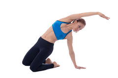 Stretching of quadriceps and pelvis. Stretching pose executed with a professional trainer Royalty Free Stock Image