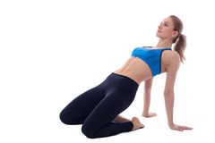 Stretching of quadriceps. Stretching pose executed with a professional trainer Royalty Free Stock Photos