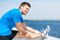 Stretching before running. Royalty Free Stock Photography