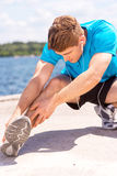 Stretching before running. Royalty Free Stock Images