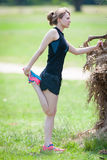 Stretching before running. Let`s go running! First stretch Royalty Free Stock Photos