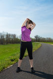Stretching before running workout . Royalty Free Stock Images