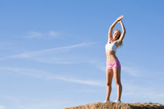 Stretching sport fit woman summer blue sky Royalty Free Stock Image