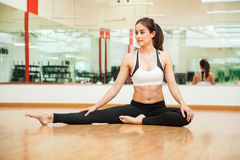 Stretching and warming up at the gym Stock Images