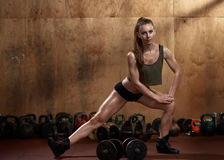 Stretching before weightlifting Stock Image
