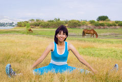 Stretching Woman. Woman Stretchs and exercises outside Stock Image