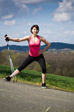 Stretching woman. A young woman stretching for nordic walking royalty free stock image