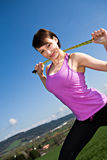 Stretching woman. A young woman stretching for jogging stock image