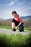 Stretching woman. A young woman stretching for nordic walking royalty free stock photography
