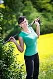 Stretching woman. A young woman stretching for nordic walking royalty free stock photos