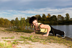 Stretching woman Royalty Free Stock Photo